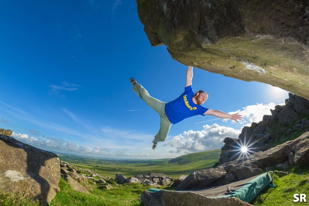 Liam Fyfe holding the swing whilst Bouldering in the Preseli Hills, Pembrokeshire.